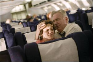 Becky London and Tom O'Rourke as Jean and Donald Peterson comfort one another aboard United Airlines Flight 93 in the unflinching drama