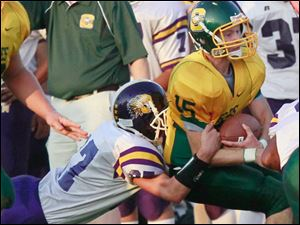 Waite H.S. #27, Kennith Hade, tackles Clay #15 Brett Jordan on the sidelines. Clay High School football team hosts Waite High School, in Oregon, Ohio on September 9, 2011.