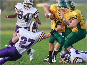 Waite H.S. #27, Kennith Hade, reaches for Clay #15 Brett Jordan. Waite defeated Clay 15-7.