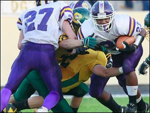 Waite #23, Devin Carter, is tackled after gaining a few yards.