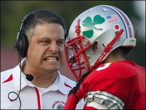 Central Catholic head coach Greg Dempsey has a few words with Jake Garcia (3)  Friday.