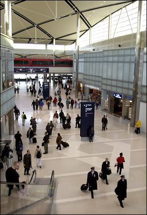 Passengers and flight crews walk through the Edward H. McNamara Terminal at Detroit Metro Airport.