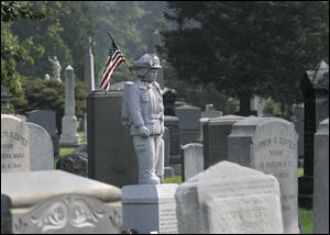 The granite figure of a firefighter in full gear stands over the grave of Michael J. Bocchino at the Green-Wood Cemetery in New York's Brooklyn borough. On Sept. 11, 2001, cemetery workers watched in disbelief from the highest point in Brooklyn as the twin towers of the World Trade Center collapsed after being attacked by terrorists. Green-Wood ultimately became the final destination for 79 victims of the attack, including Bocchino, 45, who belonged to Brooklyn's Battalion 48.