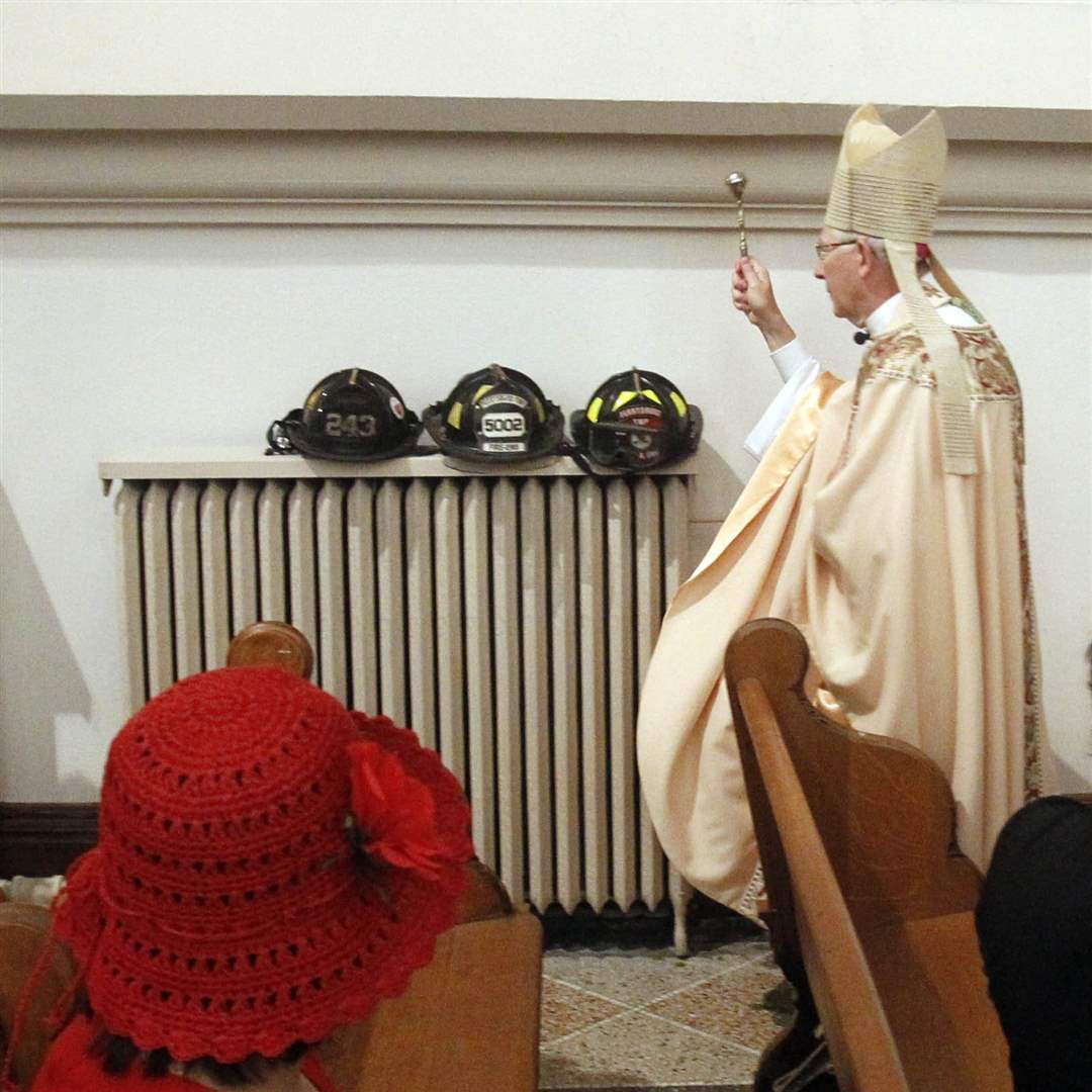 bishop-blesses-helmets