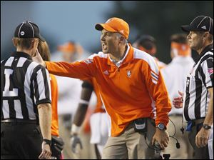 Bowling Green coach Dave Clawson argues an offside call against the Falcons at the end of the first quarter.