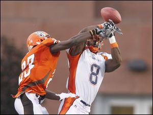 Bowling Green's Aaron Foster (23) breaks up a pass intended for Morgan State's Lamont Bryant (8) during the first quarter of their game.