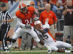 Bowling Green's Jerry Gates (24) tries to pull away from Morgan State quarterback Robert Council  after he intercepted Council's pass during the first quarter.