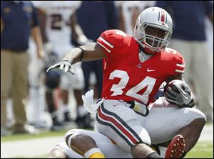 Ohio State running back Carlos Hyde (34) runs the ball against Toledo Saturday, 09/10/11, in Columbus, Ohio.