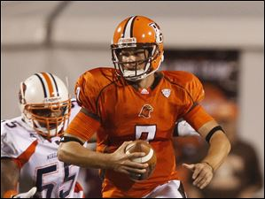 Bowling Green quarterback Matt Schilz  is chased by Morgan State's Michael Dallas II (55)  during the second quarter.
