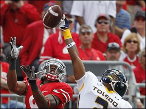 Toledo cornerback Taikwon Paige (2) bats down a pass intended for Ohio State wide receiver Verlon Reed (9)  during the first quarter.