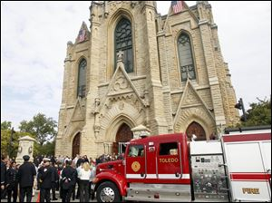 People pour out of the church after the Firefighters Mass at Historic Church of St. Patrick for firefighters and their families on Sept. 11.
