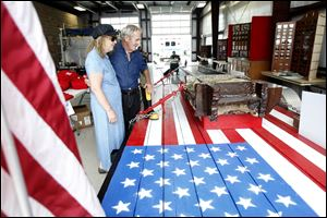 Janice Pennington of Fulton County and Earl Ogren of Lambertville look over a steel beam from the World Trade Center that was on display at the Fulton County Fair. The beam eventually will be part of a permanent memorial at the fairgrounds.