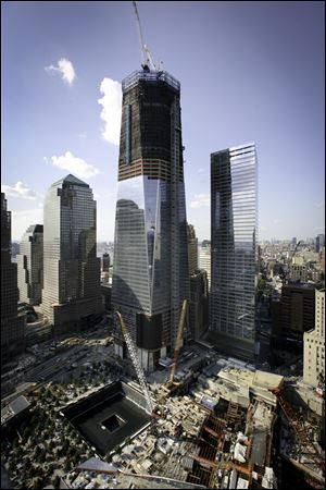 One World Trade Center and Seven World Trade Center rise adjacent to the site where the twin towers stood.