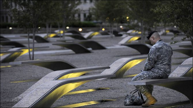 Tevye Yoblick Pentagon Memorial Maj. Tevye Yoblick spends a quiet moment at dawn at the Pentagon Memorial. The memorial includes an illuminated bench for each victim of the attack on the U.S. Defense Department's headquarters.