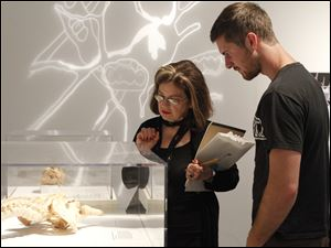 UT Professor of Art, Diana Attie, left, looks at an exhibit with UT student Patrick McDonagh, in the Bodies Revealed exhibit while in Life Drawing Class at Imagination Station.