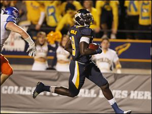 Toledo's Danny Noble scores a touchdown during the first quarter of play against  Boise State at the Glass Bowl in Toledo, Friday, September 16, 2011.