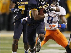 Toledo's Eric Page is pursued by Boise State's George Iloka ,8.