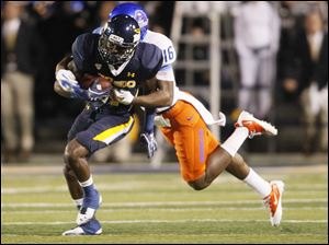 Toledo's Bernard Reedy is tackled by Boise State's Cedric Febis after picking up a first down.