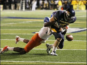Dantin fumbles the ball after being hit by Boise State's Cedric Febis during the third quarter.