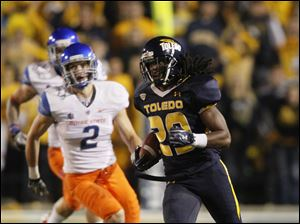 Toledo's Jermaine Robinson heads up field after intercepting a Boise State pass in the third quarter.