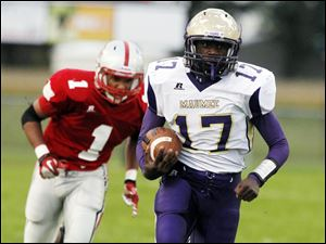 Maumee's Brandon Phenix dashes ahead of Bowling Green's Trey Loescher.