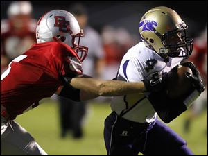 A Bowling Green defender can't stop Maumee's Sean McGovern from making scoring touchdown.
