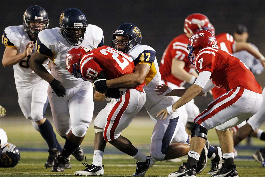 Whitmer-Chris-Wormley-tackles-St-Francis-Jarrod-Jefferson