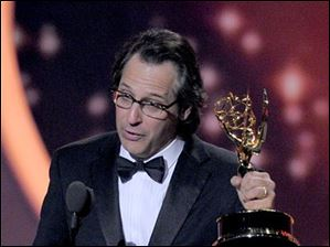 Jason Katims accepts the award for best writing for a drama series for