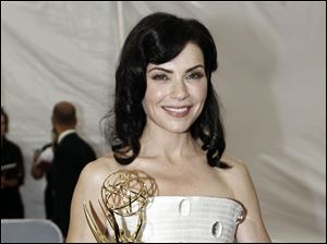 Julianna Margulies is seen backstage after winning the award for outstanding lead actress in a drama series at the 63rd Primetime Emmy Awards.
