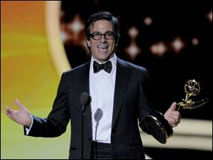 Michael Alan Spiller accepts the award for outstanding directing for a comedy series for Modern Family