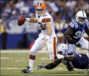 Colt McCoy escapes from the Colts' Robert Mathis Sunday. McCoy, who struggled in the opener, bounced back against Indianapolis. He was 22-of-32 passing for 211 yards, helping the Browns improve to 1-1.