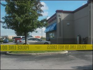 Police tape blocks access to the Fremont Pike IHOP during a raid Tuesday.
