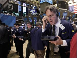 Trader Joseph Chirico works on the floor of the New York Stock Exchange.