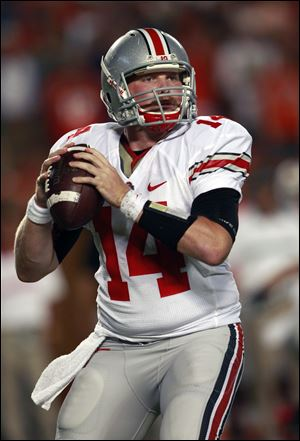 Ohio State quarterback Joe Bauserman drops back to pass during the first quarter of an NCAA college football game against Miami, Saturday, Sept. 17, 2011, in Miami.