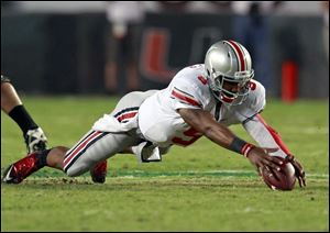 Ohio State quarterback Braxton Miller recovers his own fumble during the third quarter of an NCAA college football game against Miami, Saturday, Sept. 17, 2011, in Miami. Miami defeated Ohio State 24-6.