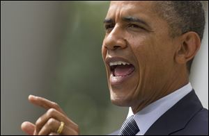 President Barack Obama discusses the national deficit in a speech Monday from the Rose Garden of the White House.