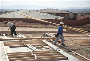 Carpenters work on the frame of a new home under construction in Las Vegas.