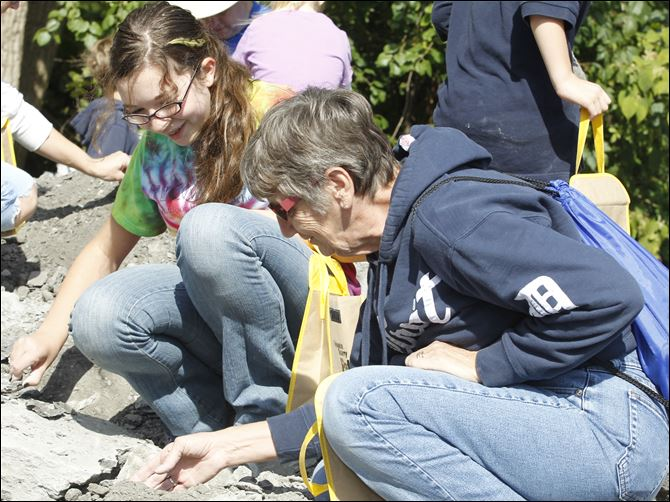 Kyleigh Pero, 13, left, of Graytown, Ohio, looks for fossils with her grandmother Sharon Pauwels of Toledo during the Annual Fossil Fest at Sylvania Historical Village.