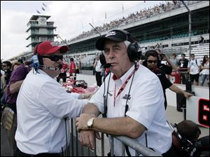 Car owners Roger Penske, right, and Chip Ganassi look on during the first day of qualifications for the Indianapolis 500 auto race at the Indianapolis Motor Speedway in Indianapolis in this May 22, 2010, file photo.