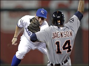 Detroit Tigers' Austin Jackson (14) is caught stealing second base by Kansas City Royals second baseman Johnny Giavotella during the third inning of a baseball game Tuesday, Sept. 20, 2011, in Kansas City, Mo.