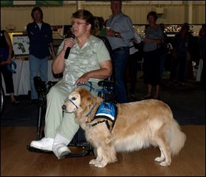 Deb Wagner, with service dog Scarlet, talks to guests about what it means to her to have a service dog.