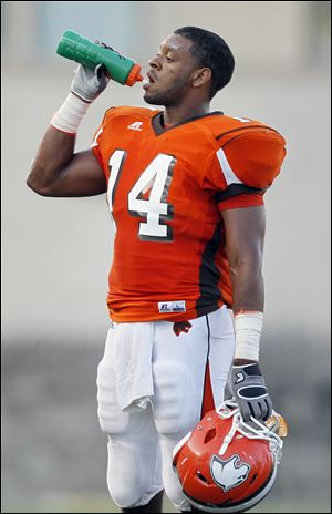 Southview player Allen Gant cools off during a timeout in a game with St. Francis at the Glass Bowl, Friday, August 26, 2011.