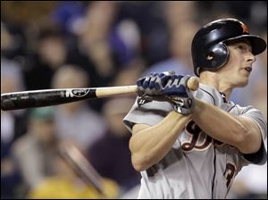 Detroit's Don Kelly hits a two-run home run in the eighth inning last night against Kansas City.