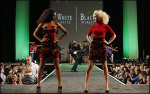 Models display red-and-black ensembles the 2010 EPIC Rocks Fashion Show.