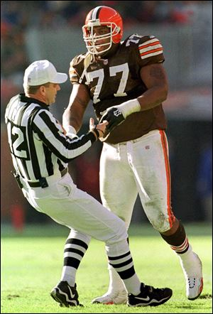 Cleveland Browns offensive tackle Orlando Brown (77) shoves referee Jeff Triplette (42) to the ground during the second quarter of an NFL football game against the Jacksonville Jaguars in Cleveland. Brown, a former member of the Browns and Baltimore Ravens, was found dead, Friday, Sept. 23, 2