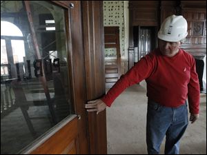 Bruce Miller, President of Miller Garmann & Associates Inc, Garmann Miller Architects, points out details on the original oak doors  in the Auglaize County  courthouse which was built in 1894 during a $8 million renovation on September 22, 2011.