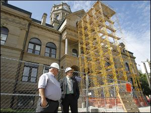 Joseph Lenhart, left, and Auglaize County Commissioner Doug Spencer, right, stand outside of the Courthouse while an $8 million renovation is still ongoing.