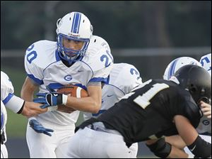 Anthony Wayne's Sam Bruno (20) suffers a 2-yard loss on the Generals' first drive of the game against Perrysburg.