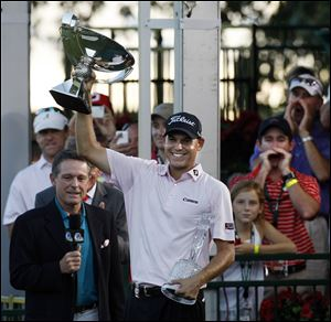 Bill Haas celebrates winning the FedEx Cup. His win Sunday resulted in a combined prize of $11.44 million.