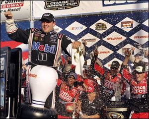 Tony Stewart celebrats with his crew in Victory Lane after winning the NASCAR Sprint Cup Series auto race at New Hampshire Motor Speedway on Sunday in Loudon, N.H.
